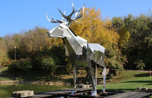 Giant deer swims in the lake of Ksilifor near Veliko Tarnovo